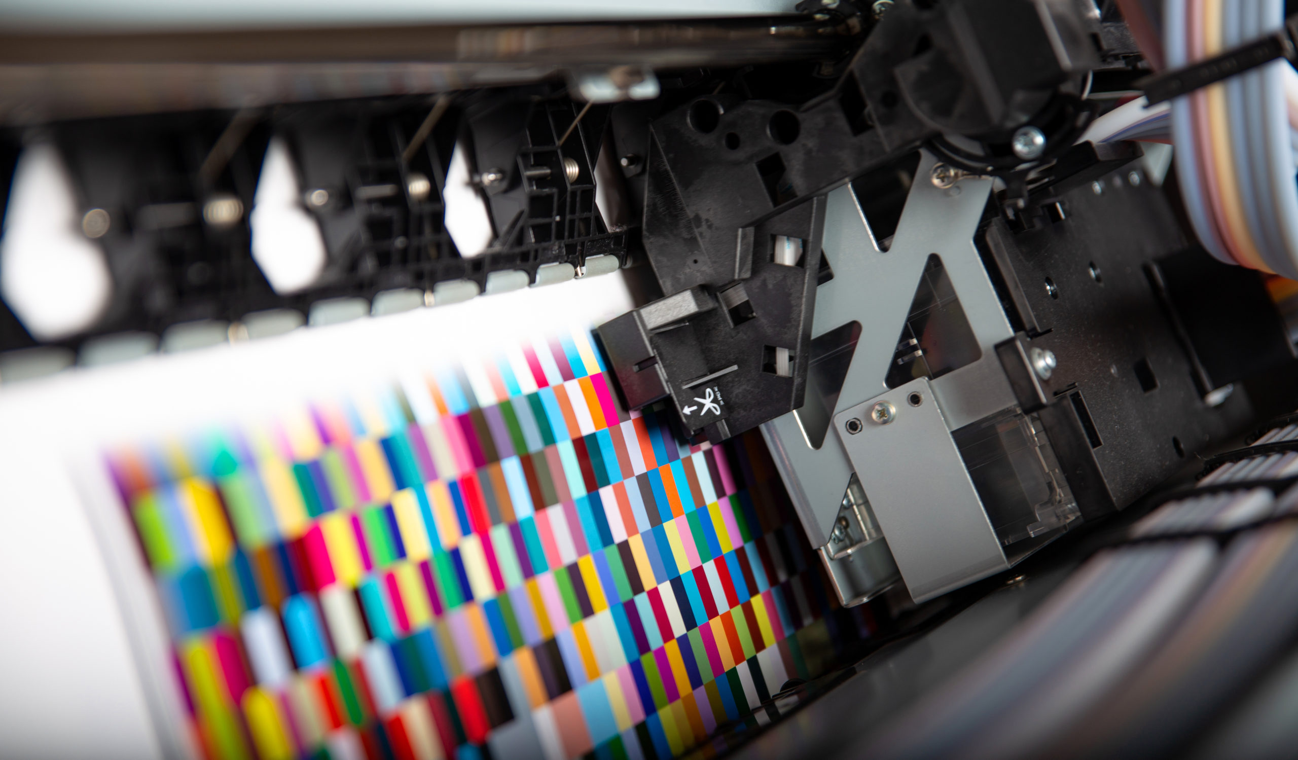 Image of Printer ink jet print machine printing color patches for color management control